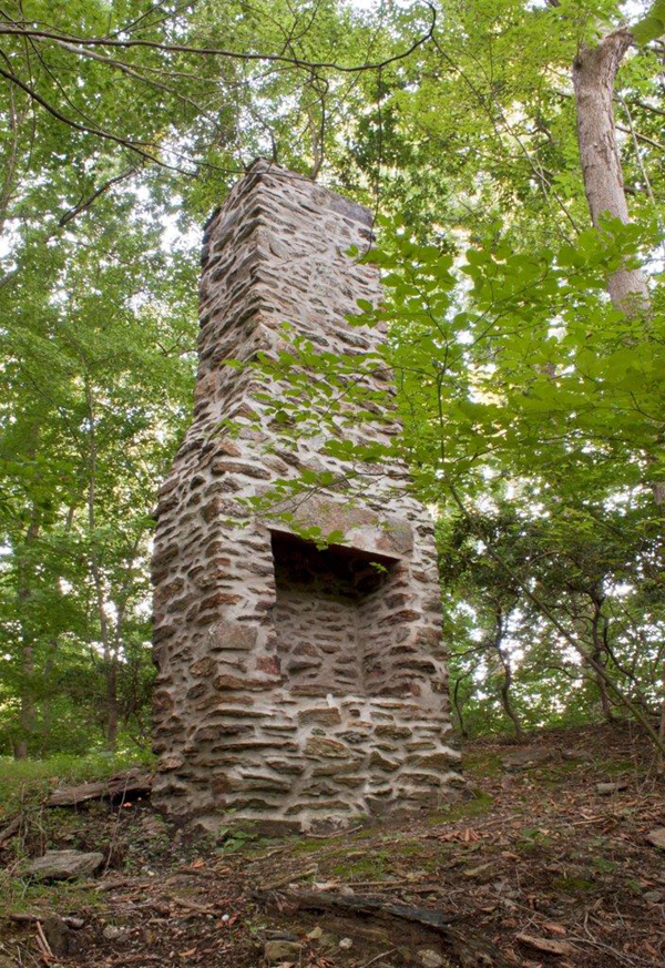 "The chimney is all that remains of the ""Seekers After Knowledge"" cabin in the Long Point Nature Preserve. Once accessible by a swinging footbridge across Ridley Creek, the cabin was the meeting place for this outing club in the 1880's. Will Price was a member of the Seekers After Knowledge years before returning to Rose Valley to create his Arts and Crafts community. Photo by Anne Marie Palita Smith"